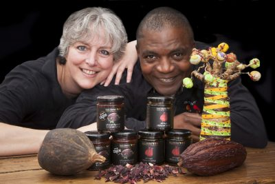 Pictured are Nicola and James  Adedeji from Bim's Kitchen launch two new products (African Baobab & Cacao Syrup and African Hibiscus Syrup) at the Hamper Llangollen food festival .