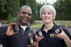 Pictured are James and Nicola Adedeji from Bim's Kitchen launch two new products (African Baobab & Cacao Syrup and African Hibiscus Syrup) at the Hamper Llangollen food festival .